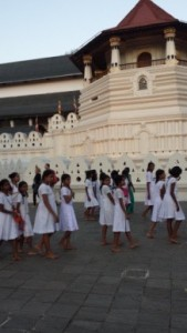 Sri Lankan school girls paying respect at the Temple of the Sacred Tooth Relic, Kandy